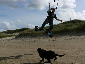 Kite landboarding - Landboard rider in North Mayo, Ireland, wearing helmet and knee pads