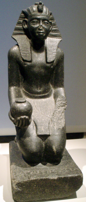 A kneeling statue of Sobekhotep V, one of the pharaohs from the declining years of the Middle Kingdom. KneelingStatueOfSobekhotepV-AltesMuseum-Berlin.png