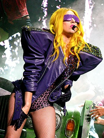 Gaga performing on The Monster Ball Tour in 2010. It grossed $227 million and became the highest-grossing concert tour for a debut headlining artist. Lady Gaga Glitter and Grease2.jpg