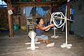 Laos - a Katang woman spinning cotton.JPG