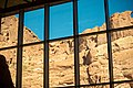 Large windows in the back of the visitor center reveal the steep rocky cliffs behind it. (86a11250-0366-445d-aa53-a16acab56ed6).jpg
