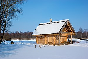 English: A Latvian sauna house covered by snow...