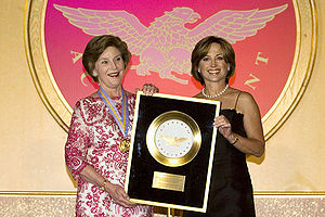 Dorothy Hamill - Hamill (right) presents Laura Bush the Academy of Achievement Golden Plate Award, June 22, 2007.