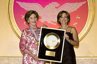 Dorothy Hamill - Hamill (right) presents Laura Bush the Academy of Achievement Golden Plate Award, June 22, 2007.