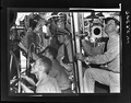 Lcdr. John R. Madison prepares to go up ladder from control room of USS Muskallunge (SS 262) at submarine base New... - NARA - 520835.tif