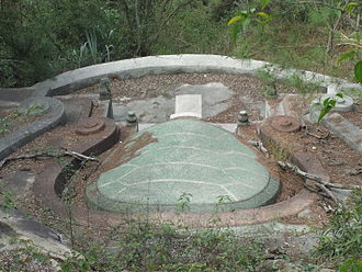 "Feng shui - A traditional turtle-back tomb of southern Fujian, surrounded by an omega-shaped ridge protecting it from the ""noxious winds"" from the three sides"