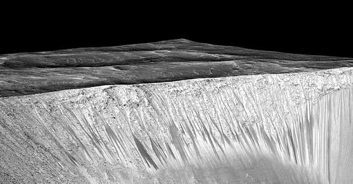 28 September: After a review of evidence from the Mars Reconnaissance Orbiter, NASA concluded that liquid water occurs on present day Mars. Liquid water on mars.jpg
