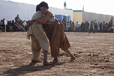 Local boys wrestle, outside of the Zhari District Center, Kandahar province, Afghanistan, Dec. 24, 2011 111224-A-VB845-033.jpg
