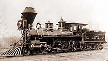 A black-and-white image of an old steam locomotive and tender bearing a resemblance to the DRR's No. 1 locomotive and tender