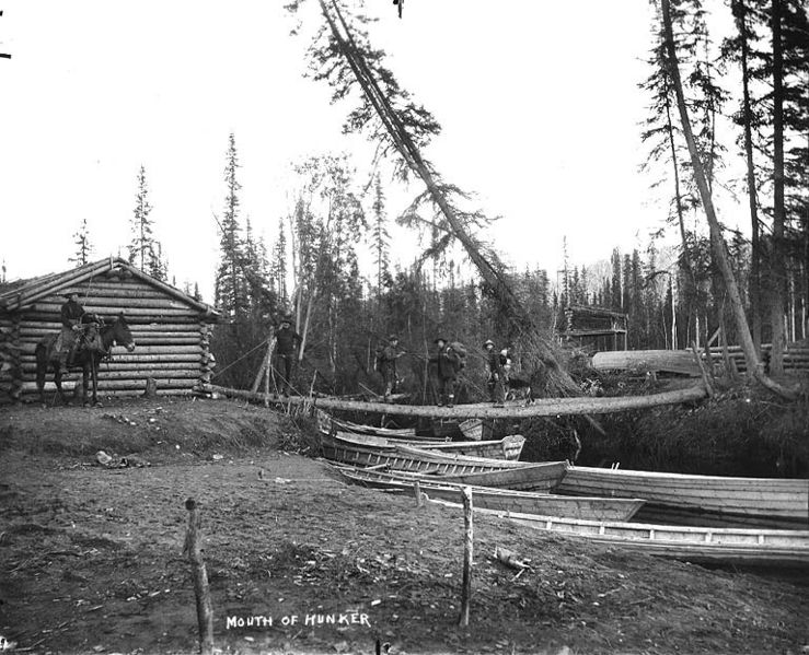 File log cabin and boats at the mouth of hunker creek for 123 cabins