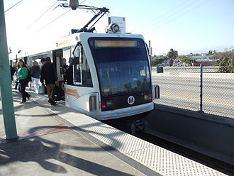 Los Angeles Metro Rail - Westbound Metro Green Line train to Redondo Beach Station arrives at Long Beach Boulevard Station.
