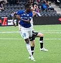 Luc Kassi (blue shirt).jpg