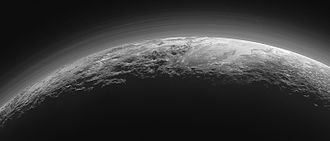 Atmosphere of Pluto - Haze with multiple layers in the atmosphere of Pluto. Part of the plain Sputnik Planitia with nearby mountains is seen below. Photo by New Horizons, taken 15 min after the closest approach to Pluto.