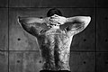 Man with a backpiece Christian and Enlightenment tattoo. Black and White.jpg