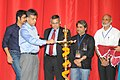 """Manish Tewari lighting the lamp to inaugurate the """"Indian Cinema 100 (Celebrating a Century An Audio Visual Voyage)"""" Exhibition to mark the commencement of the week long - Centenary Film Festival, in New Delhi. The Secretary.jpg"""