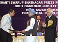 Manmohan Singh giving away the Shanti Swarup Bhatnagar Prize for Science and Technology 2008 to Dr. L.S. Shashidhara of Hyderabad for his outstanding contribution in Biological Sciences, in New Delhi on December 20, 2008.jpg
