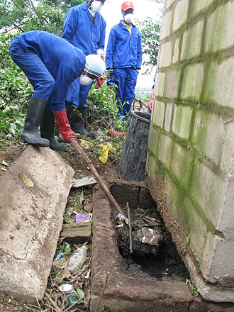 Pit latrine - Manual pit emptying of a pit latrine near Durban, South Africa