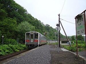 Masuura Station - A train arriving at Masuura Station in June 2010