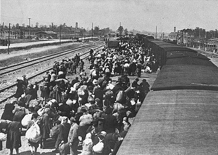 Carpathian Ruthenian Jews arrive at Auschwitz-Birkenau, May 1944. Without being registered to the camp system, most were killed in gas chambers hours after arriving (A photograph from a collection known as the Auschwitz Album) May 1944 - Jews from Carpathian Ruthenia arrive at Auschwitz-Birkenau.jpg