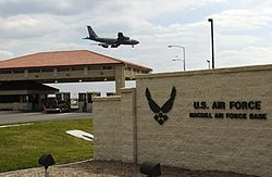 The main gate at MacDill AFB, with a KC-135R Stratotanker overhead.