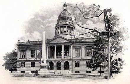 In 1898, this monument was erected in front of the Mecklenburg County Court House to honor the signers of the Mecklenburg Declaration. The building no longer exists, but the monument now stands behind another old court building. Mecklenburg County Court House 1898.jpg