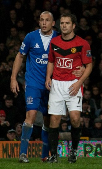Michael Owen - Owen (right) playing for Manchester United, with Everton's John Heitinga.