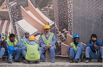 Human rights in Qatar - Migrant construction workers from South Asia in the West Bay area of Doha.