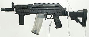 FB Mini-Beryl - The Mini-Beryl with a long receiver MIL-STD-1913 rail, vertical grip and telescopic stock.