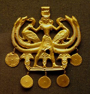 Master of Animals - Egyptianizing gold pendant showing the Lord of the Animals, Minoan (British Museum)