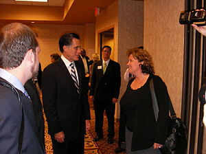 Former Massachusetts Gov. Mitt Romney talks to...