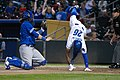 Mondesi with a colorful slide (36601192815).jpg