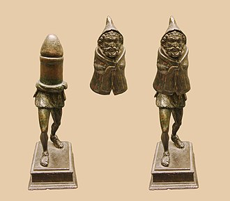 Priapus - Gallo-Roman bronze statuette (ca 1st century CE) of Priapus (or a Genius cucullatus?) discovered in Picardy, northern France, made in two parts, with the top section concealing a giant phallus.