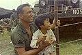 NARA 111-CCV-293-CC44662 1st Infantry Division holding Vietnamese child 1967.jpg