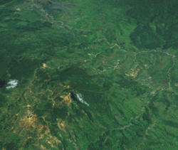 A satellite image of Wau and her mines, looking towards Bulolo