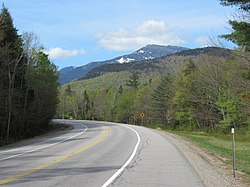 New Hampshire Route 16 in Martin's Location, May 2019. Mount Washington rises to the south, outside the township.