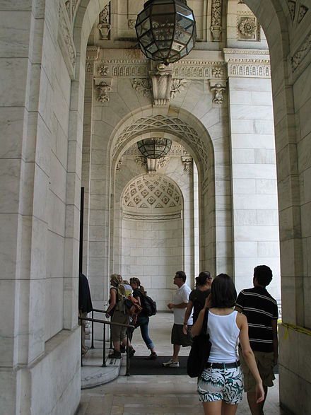 Cross-view of classical details in the entrance portico NYPL portals.JPG