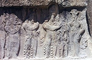 Anahita - Naqsh-e Rustam investiture of Narseh (r. 293-302), in which the Sassanian king (second from right) receives the ring of kingship from Anahita (right).