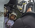Naval Aircrewman 2nd Class Logan Parkinson prepares a patient's family for evacuation during relief efforts in the wake of Hurricane Maria (37206117232).jpg