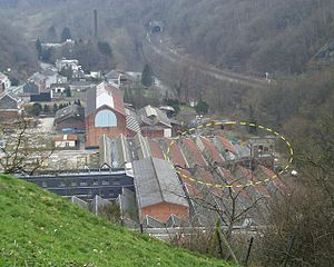 Trooz - The Imperia car factory at Nessonvaux, photographed in 2004: part of the 1928 roof-top test track can be seen on the right side of the building and has been ringed in this picture.