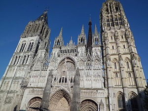Walter de Coutances - The front of Rouen Cathedral. The left tower (except the last storey) and the side doors (except the tympans) date from the 12th century, and already existed in Coutances' lifetime.