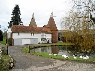Oast house building designed for kilning (drying) hops as part of the brewing process