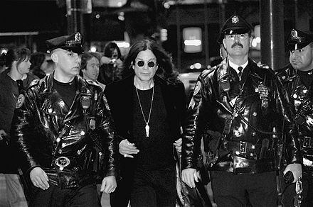 Osbourne, flanked by Philadelphia police officers, leaves Borders in Center City after signing copies of his autobiography, I Am Ozzy on 27 January 2010. OzzyOsbourne-1.jpg