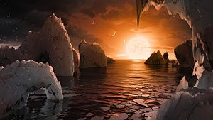 TRAPPIST-1f - Artist's impression of the surface of TRAPPIST-1f, depicting a liquid water ocean on its surface. The parent star and neighbouring planets are also illustrated.
