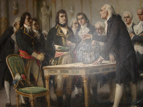 "Volta explains the principle of the ""electric column"" to Napoleon in 1801 Painting of Volta by Bertini (photo).jpeg"