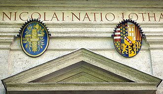 National emblem of France - National coat of arms (left) displayed on the Church of Saint Nicholas of the Lorrainers in Rome, dedicated to France