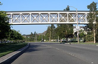 Valencia, Santa Clarita, California - A typical stretch of Newhall Ranch Road. The bridge carries a paseo over the roadway.