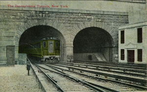 New York Tunnel Extension - An electric engine exiting one of the tunnels at Penn station, ca. 1910