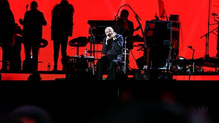 "Collins performing to 65,000 at Hyde Park, London on 30 June 2017. Music critic Neil McCormick wrote, ""He could barely walk but Phil Collins still knocked it out of Hyde Park"". Phil Collins - BST Hyde Park - Friday 30th June 2017 PCollinsBST300617-26 (35649688476).jpg"