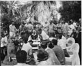 """Photograph of President Truman holding a press conference in the garden of the """"Little White House"""" during his... - NARA - 200557.jpg"""