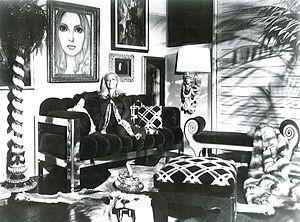 Phyllis Morris - Phyllis Morris in her Beverly Boulevard showroom in the early 1970s surrounded by a colorful array of furnishings including a large portrait by Margaret Keane whom Morris befriended in the early 1960s